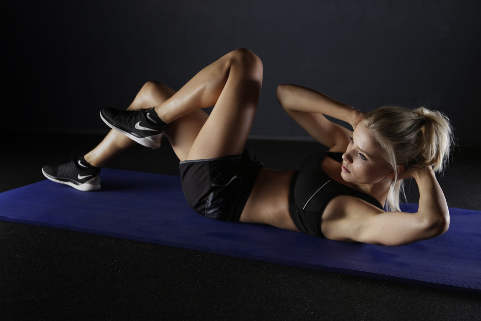 person doing exercises on floor
