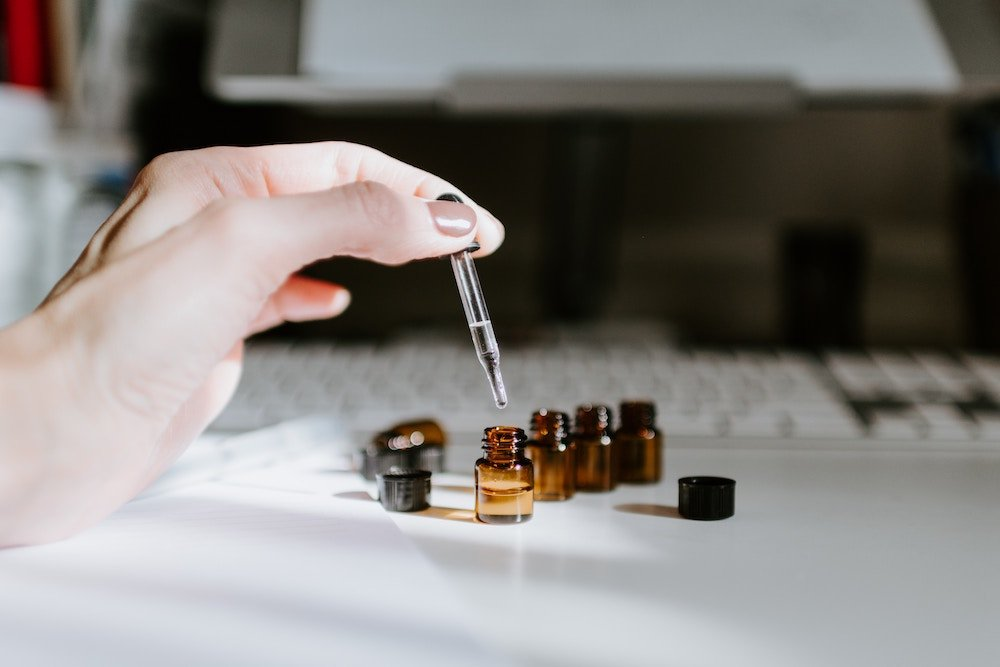 small bottles with oil and a pipette