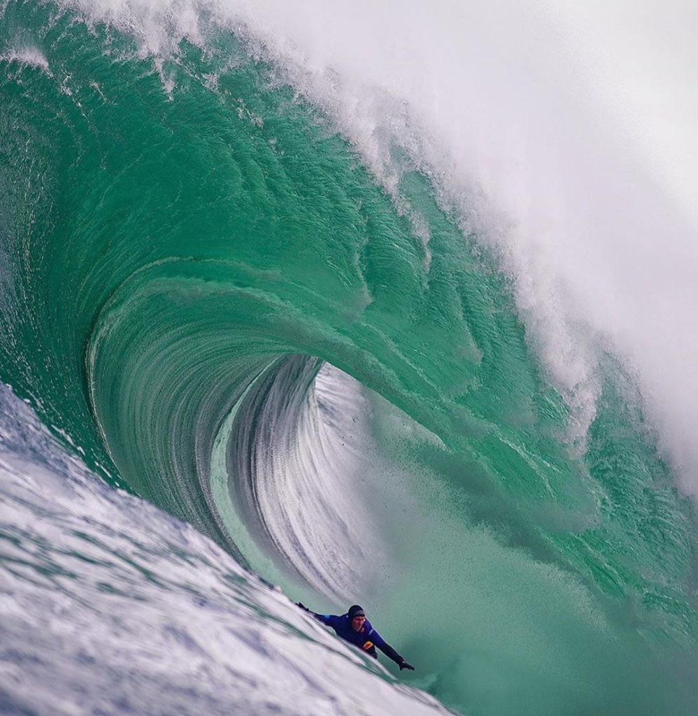 from the water image of andrew riding a big wave