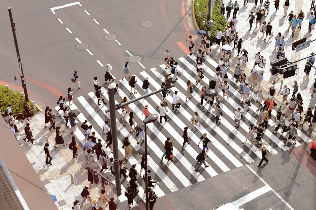 People walking across a crossing