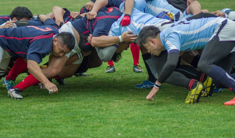 Two rugby teams in a physical scrum