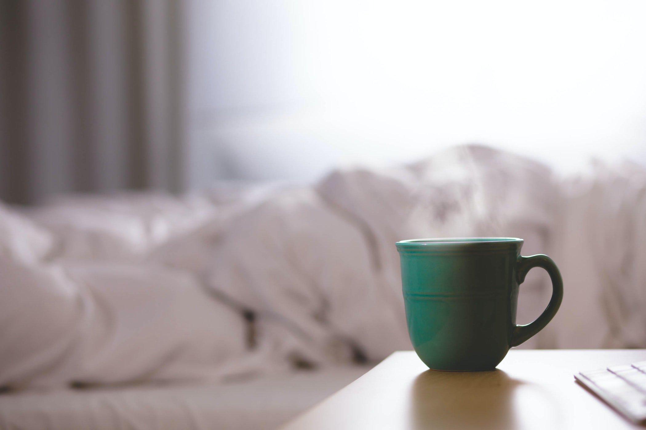 A mug by a bed