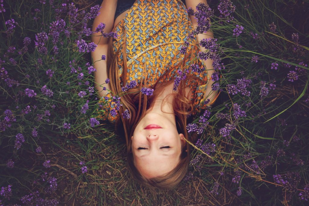 A woman asleep surrounded by lavender