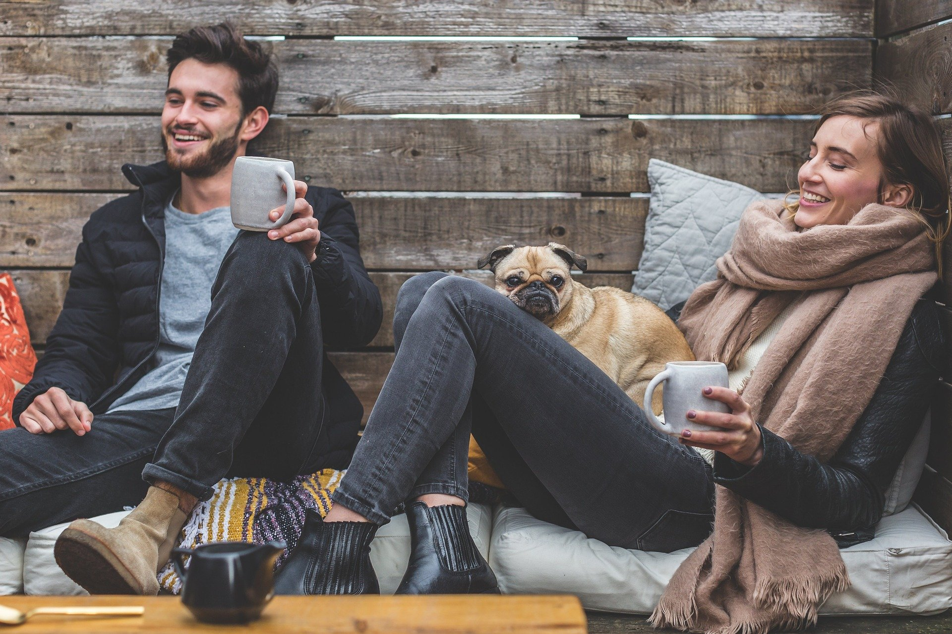 Two people relaxing with a dog and enjoying a conversation