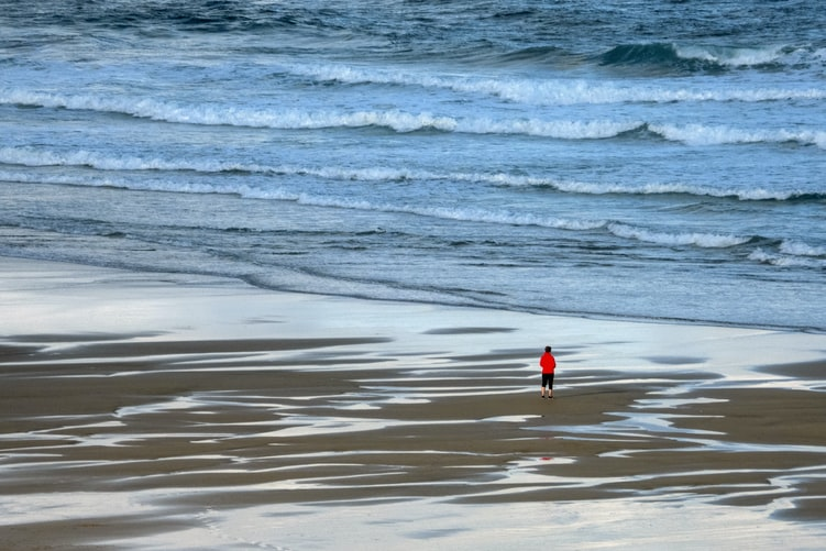 Someone standing by the sea